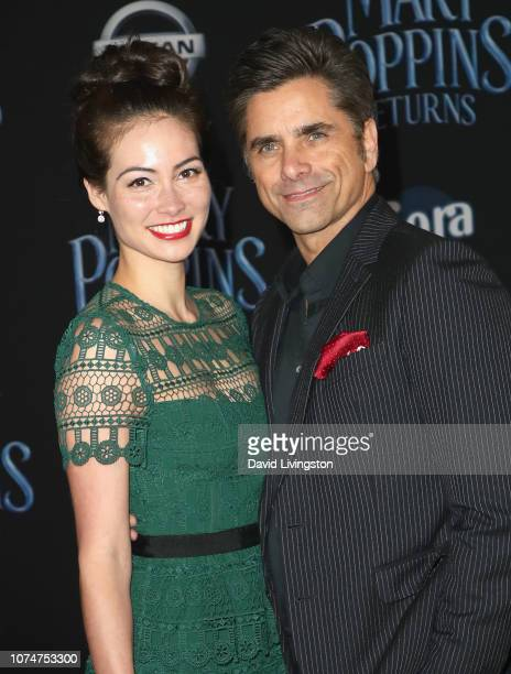Caitlin Mchugh and John Stamos attend the Premiere Of Disney's Mary Poppins Returns at El Capitan Theatre on November 29 2018 in Los Angeles...