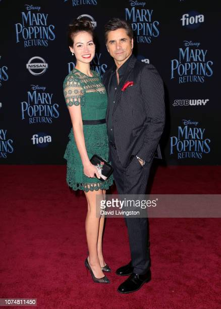 Caitlin McHugh and John Stamos attend the premiere of Disney's Mary Poppins Returns at the El Capitan Theatre on November 29 2018 in Los Angeles...
