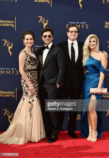 Caitlin McHugh John Stamos Bob Saget and Kelly Rizzo attend the 2018 Creative Arts Emmy Awards at Microsoft Theater on September 8 2018 in Los...