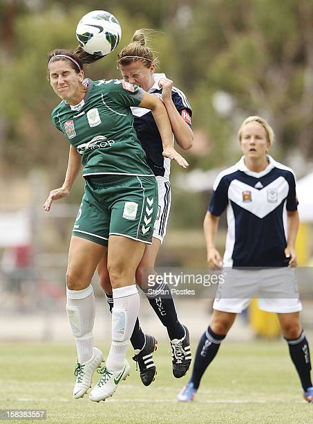Caitlin Munoz of Canberra United and Amy Jackson of Melbourne Victory contest possession during the round nine W-League match between Canberra United...