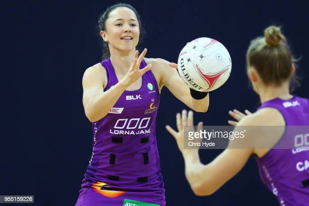 Caitlin Nevins of the Firebirds warms up ahead of the round two Super Netball match between the Firebirds and the Lightning at Brisbane Entertainment...