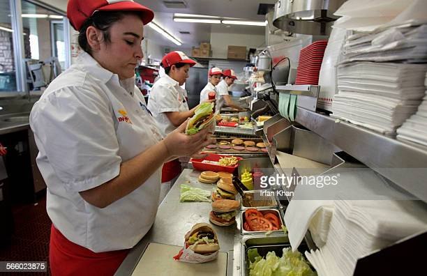 Caitlin Pogue prepares burgers for lunch customers at InNOut in San Marcos on February 06 2009