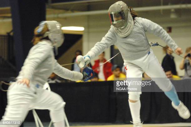 Caitlin Thompson of Penn State takes on Daria Schneider of Columbia/Barnard in the women's saber gold medal bout during the Division I Women's...