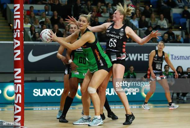 Caitlin Thwaites of the Magpies and Courtney Bruce of the Fever compete for the ball during the round nine Super Netball match between the Magpies...