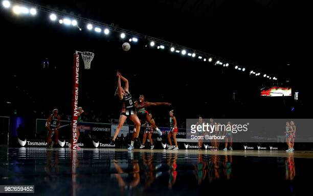 Caitlin Thwaites of the Magpies and KadieAnn Dehaney of the Vixens compete for the ball during the round eight Super Netball match between Magpies...
