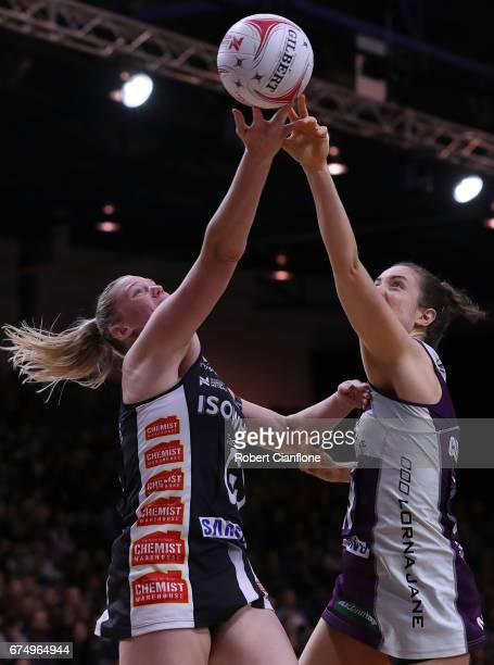 Caitlin Thwaites of the Magpies and Laura Clemesha of the Firebirds compete for the ball during the round 10 Super Netball match between the Magpies...