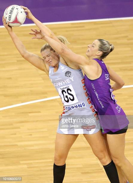 Caitlin Thwaites of the Magpies competes with Laura Geitz of the Firebirds during the round 14 Super Netball match between the Firebirds and the...