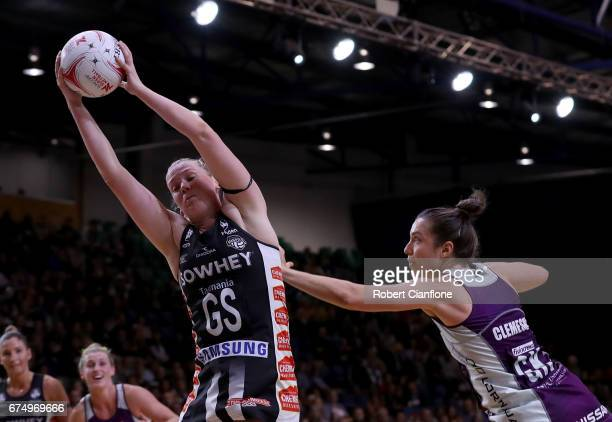 Caitlin Thwaites of the Magpies gets the ball as she is challenged by Laura Clemesha of the Firebirds during the round 10 Super Netball match between...