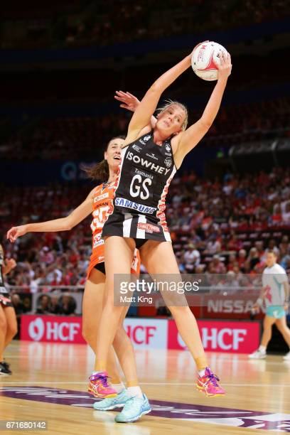 Caitlin Thwaites of the Magpies is challenged by Bec Bulley of the Giants during the round nine Super Netball match between the Giants and the...