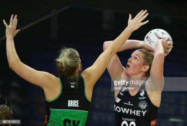 Caitlin Thwaites of the Magpies shoots as Courtney Bruce of the Fever defends during the round nine Super Netball match between the Magpies and the...