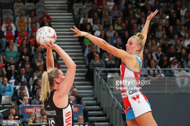 Caitlin Thwaites of the Magpies shoots under pressure from Maddy Turner of the Swifts during the round 12 Super Netball match between the Magpies and...