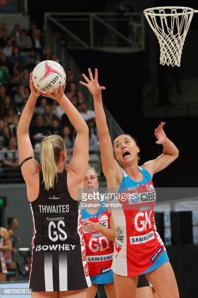 Caitlin Thwaites of the Magpies shoots under pressure from Sarah Klau of the Swifts during the round 12 Super Netball match between the Magpies and...