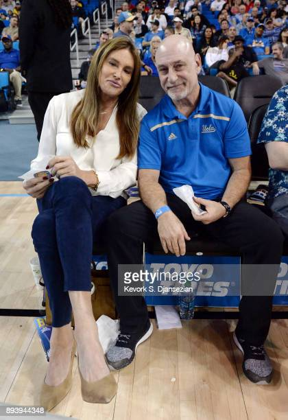 Caitlyn Jenner and publicist Alan Nierob attend the UCLA Bruins and Cincinnati Bearcats college basketball game at Pauley Pavilion on December 16...