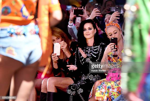 Caitlyn Jenner and singer Katy Perry attend the Moschino Spring/Summer 17 Menswear and Women's Resort Collection during MADE LA at LA Live Event Deck...