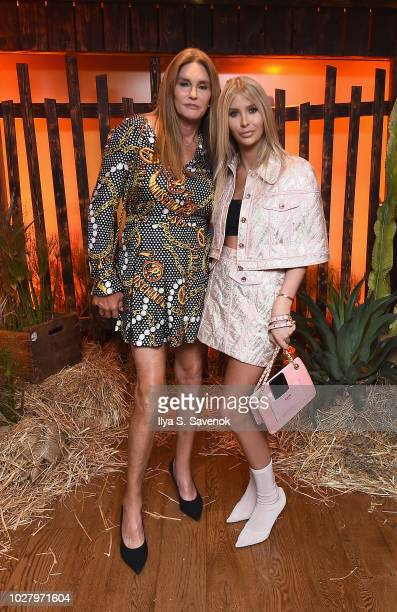 Caitlyn Jenner and Sophia Hutchins attend the launch of the Saks IT List Townhouse hosted by Glenda Bailey and Katie Holmes in partnership with...