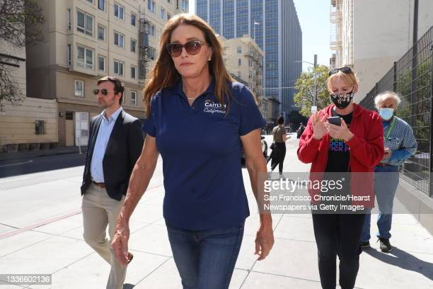 Caitlyn Jenner leaves a media event outside the Turk-Hyde Mini Park during a tour the Tenderloin on Wednesday, August 25 in San Francisco, Calif....