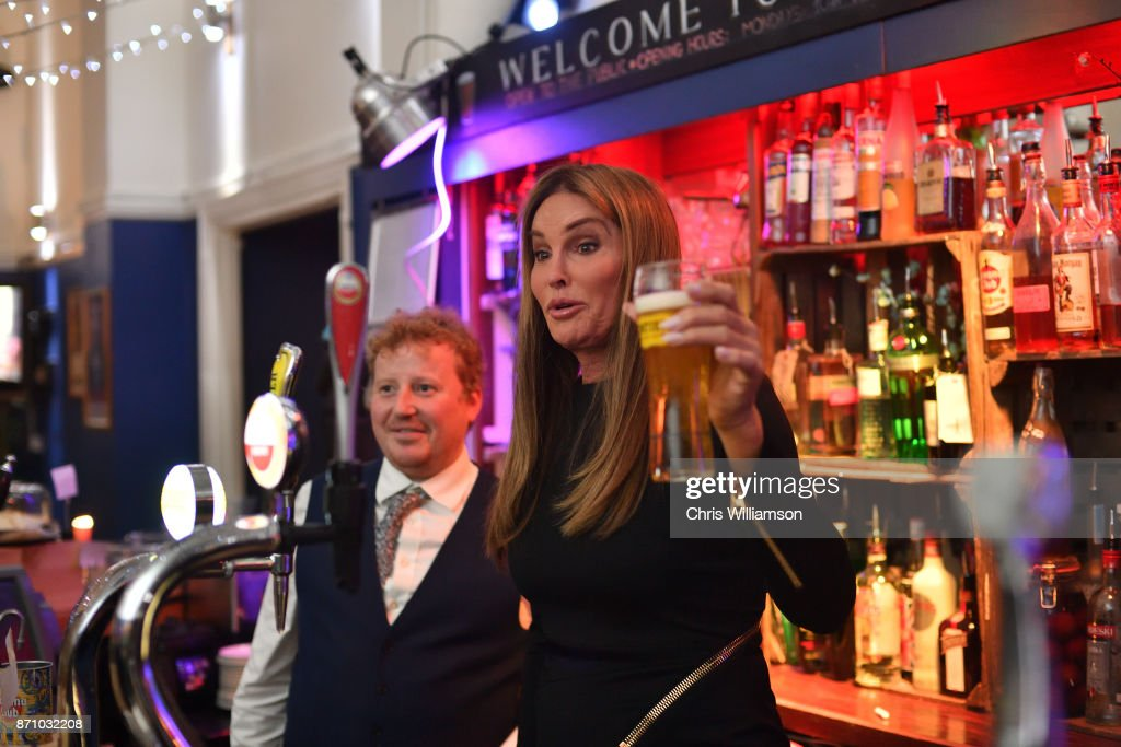 Caitlyn Jenner pours a beer at The Cambridge Union on November 6, 2017 in Cambridge, Cambridgeshire.