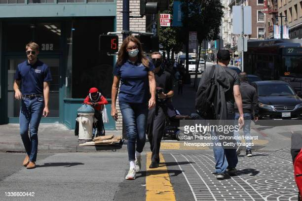 Caitlyn Jenner walks to the Tenderloin Police Department during a tour of the area on Wednesday, August 25 in San Francisco, Calif. Jenner is running...