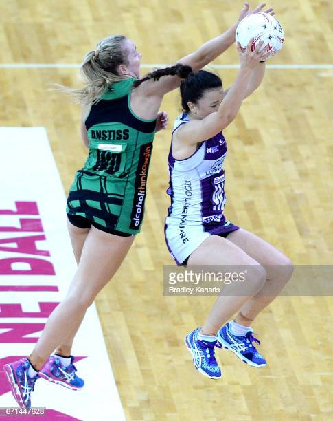 Caitlyn Nevins of the Firebirds and Jessica Anstiss of the Fever challenge for the ball during the round nine Super Netball match between the...