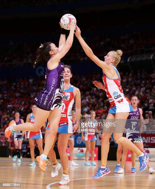 Caitlyn Nevins of the Firebirds is challenged by Maddy Turner of the Swifts during the round 14 Super Netball match between the Swifts and the...