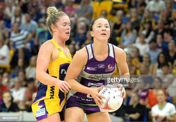 Caitlyn Nevins of the Firebirds looks to pass during the round seven Super Netball match between the Lightning and the Firebirds at University of the...