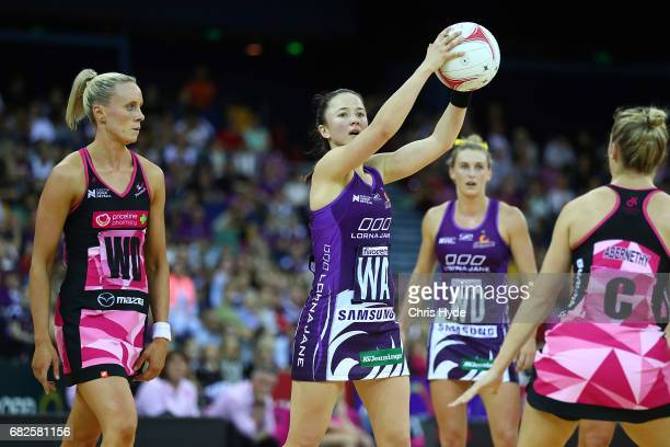 Caitlyn Nevins of the Firebirds passes during the round 12 Super Netball match between the Firebirds and the Thunderbirds at Brisbane Entertainment...