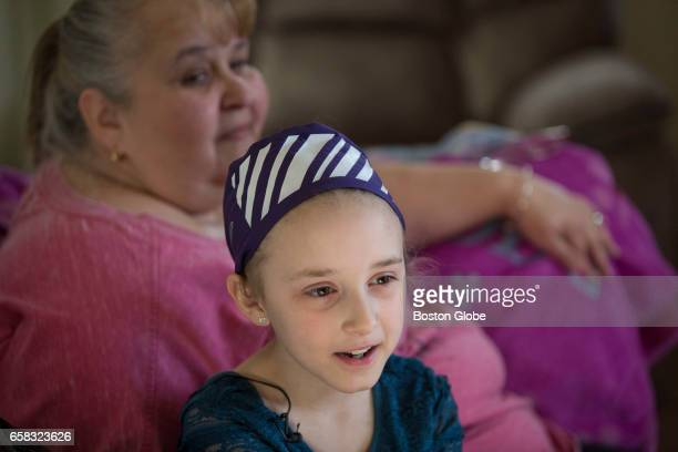 Caitlyn Rose Kasper sits with her adoptive mother Irene after she learned her genetic background from Ancestrycom at the family's home in Woburn MA...