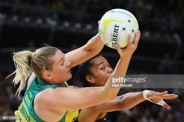 Caitlyn Thwaites of Australia wins the ball ahead of Temalisi Fahokotau of New Zealand during the 2017 Constellation Cup match between the Australian...