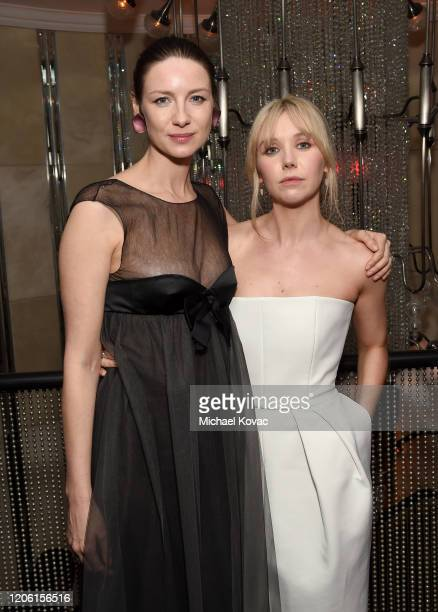 """Caitriona Balfe and Lauren Lyle attend the Starz Premiere event for """"Outlander"""" Season 5 at Beauty & Essex on February 13, 2020 in Los Angeles,..."""