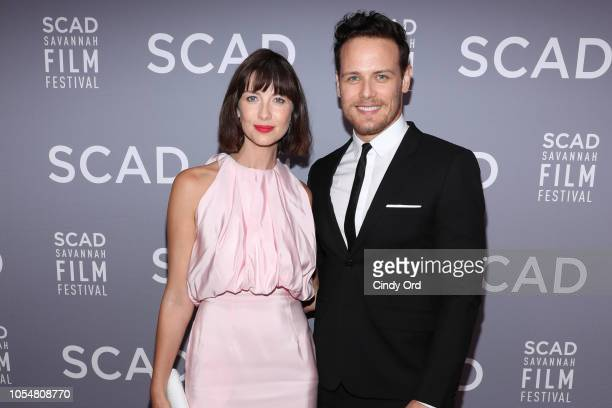 """Caitriona Balfe and Sam Heughan attend the 21st SCAD Savannah Film Festival Red Carpet for """"Outlander"""" Season Four on October 28, 2018 in Savannah,..."""