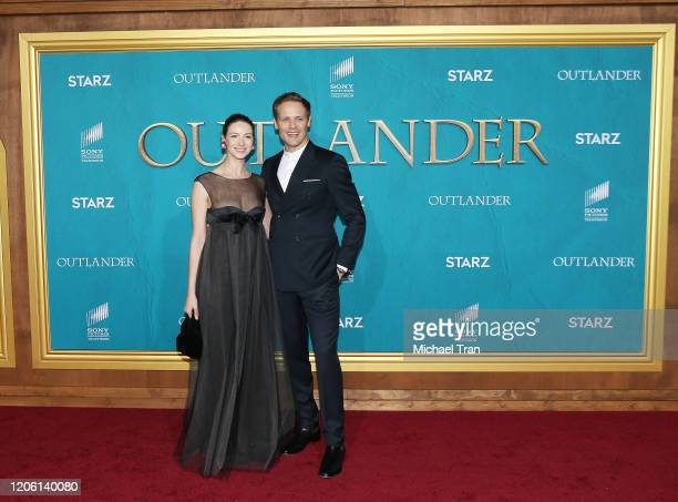 """Caitriona Balfe and Sam Heughan attend the Los Angeles Premiere of Starz's """"Outlander"""" Season 5 held at Hollywood Palladium on February 13, 2020 in..."""