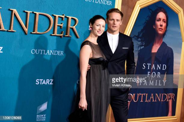 """Caitriona Balfe and Sam Heughan attend the Starz Premiere event for """"Outlander"""" Season 5 at Hollywood Palladium on February 13, 2020 in Los Angeles,..."""