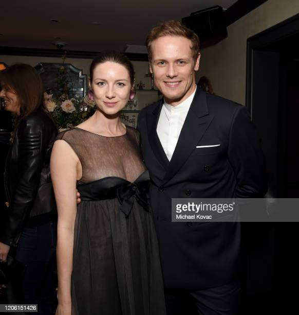 """Caitriona Balfe and Sam Heughan attend the Starz Premiere event for """"Outlander"""" Season 5 at Beauty & Essex on February 13, 2020 in Los Angeles,..."""