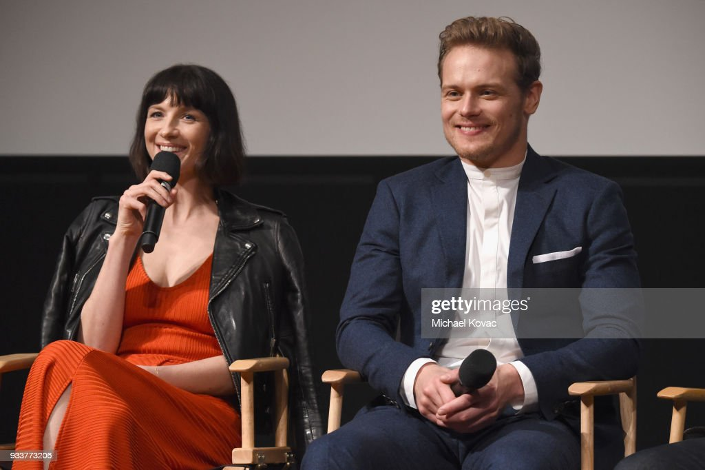 Caitriona Balfe (L) and Sam Heughan speak on stage at the STARZ Outlander FYC Event at Linwood Dunn Theater on March 18, 2018 in Los Angeles, California.