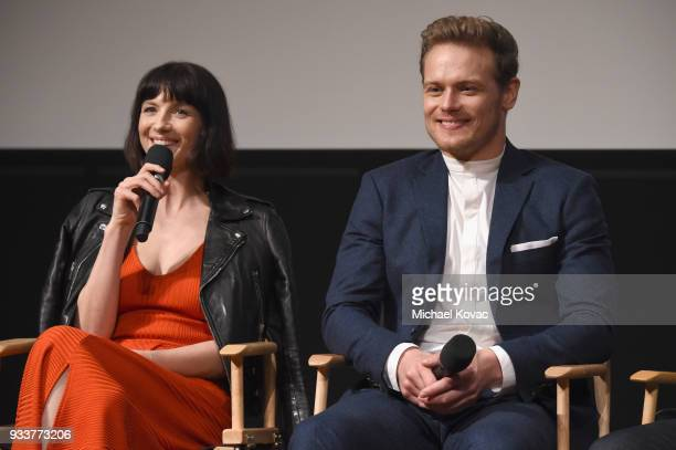 Caitriona Balfe and Sam Heughan speak on stage at the STARZ Outlander FYC Event at Linwood Dunn Theater on March 18 2018 in Los Angeles California