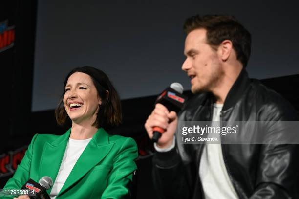 Caitriona Balfe and Sam Heughan speak on stage during Outlander panel at New York Comic Con 2019 Day 3 at Jacob K. Javits Convention Center on...