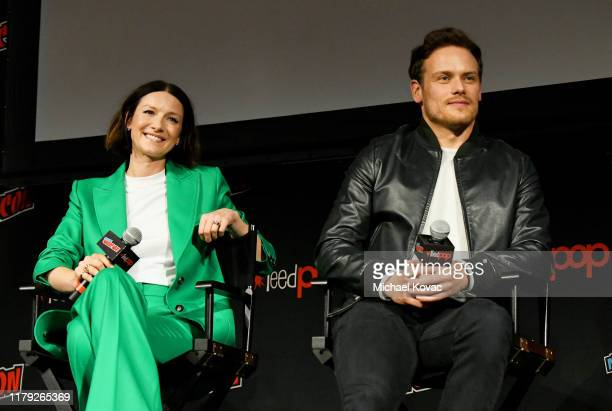 """Caitriona Balfe and Sam Heughan speak onstage during a panel for STARZ """"Outlander"""" at NYCC 2019 on October 05, 2019 at Hulu Theater at Madison Square..."""