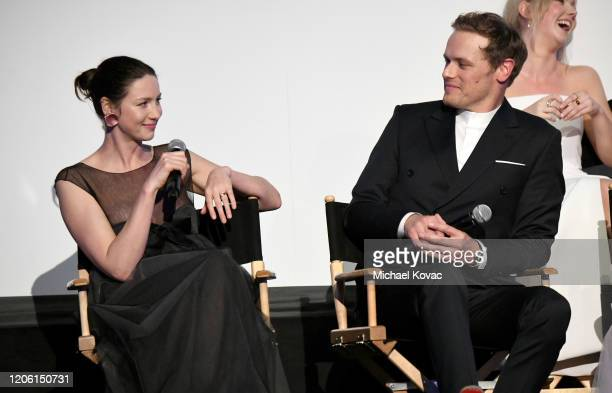 """Caitriona Balfe and Sam Heughan speak onstage during the Starz Premiere event for """"Outlander"""" Season 5 at Hollywood Palladium on February 13, 2020 in..."""