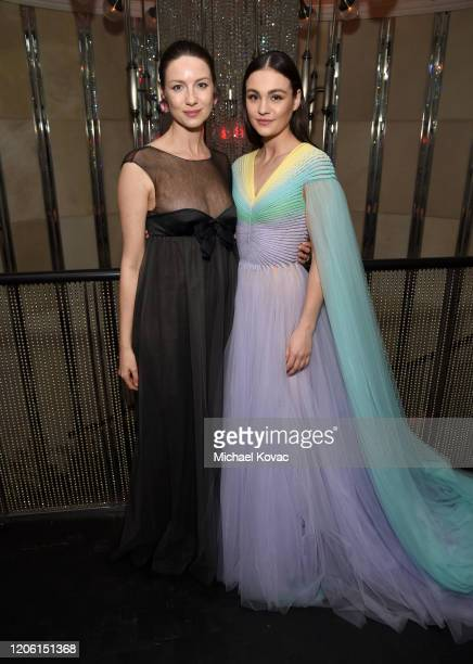 """Caitriona Balfe and Sophie Skelton attend the Starz Premiere event for """"Outlander"""" Season 5 at Beauty & Essex on February 13, 2020 in Los Angeles,..."""