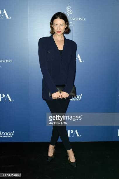 Caitriona Balfe attends The Hollywood Foreign Press Association and The Hollywood Reporter party at the 2019 Toronto International Film Festival at...