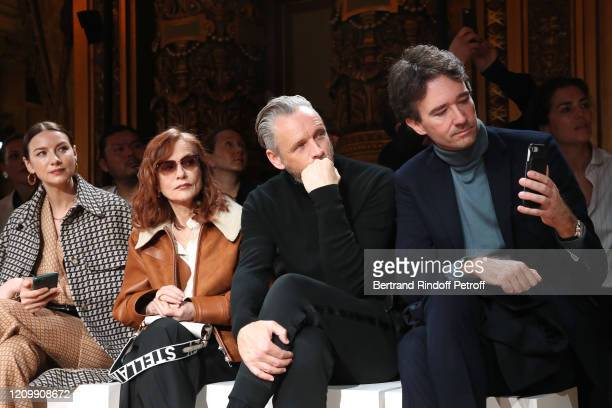 Caitriona Balfe Isabelle Huppert Alasdhair Willis and Antoine Arnault attend the Stella McCartney show as part of the Paris Fashion Week Womenswear...