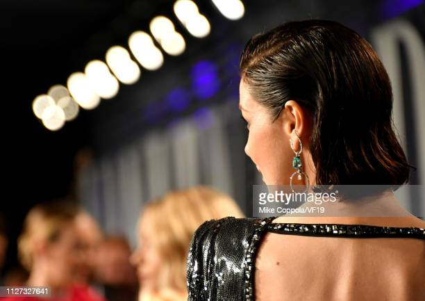 Caitriona Balfe jewelry detail attends the 2019 Vanity Fair Oscar Party hosted by Radhika Jones at Wallis Annenberg Center for the Performing Arts on...