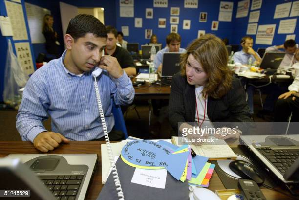 Caittlin Klevorick and Faiz Shakir both staffers work in the war room at the headquarters of the Democratic Rapid Response team on August 30 2004 in...