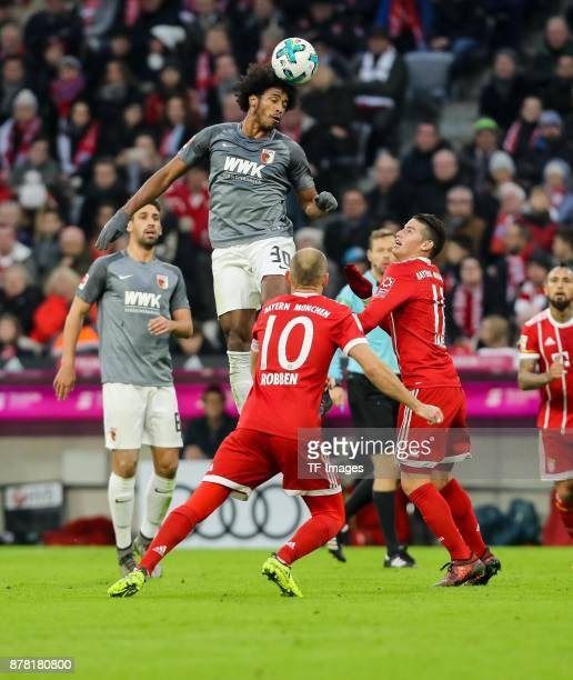 Caiuby Francisco da Silva of Augsburg and James Rodriguez of Bayern Muenchen battle for the ball during the Bundesliga match between FC Bayern...