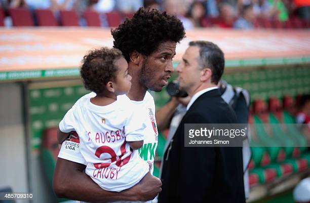 Caiuby Francisco da Silva of Augsburg arrives with his little son for the Bundesliga match between FC Augsburg and FC Ingolstadt at WWK Arena on...