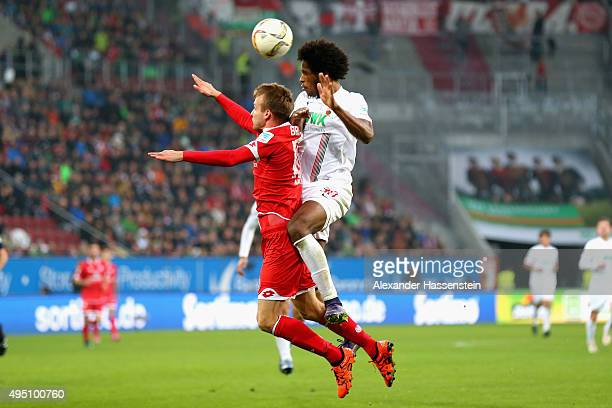 Caiuby Francisco da Silva of Augsburg battles for the ball with Stefan Bell of Mainz during the Bundesliga match between FC Augsburg and 1 FSV Mainz...