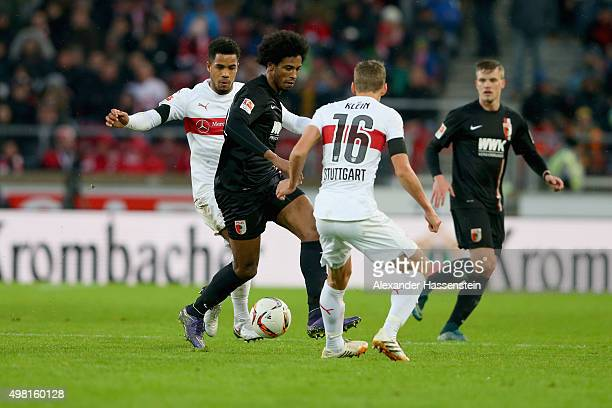 Caiuby Francisco da Silva of Augsburg battles for the ball with Daniel Didavi of Stuttgart and his team mate Florian Klein during the Bundesliga...