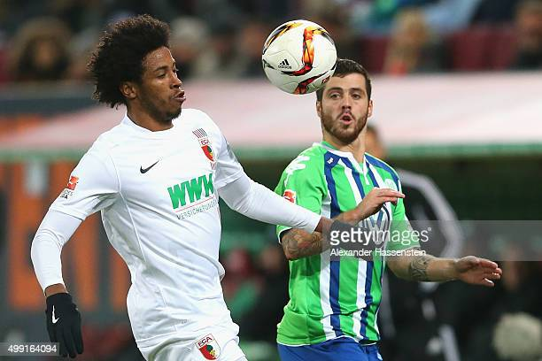 Caiuby Francisco da Silva of Augsburg battles for the ball with Freitas ViererinhaDe of Wolfsburg during the Bundesliga match between FC Augsburg and...