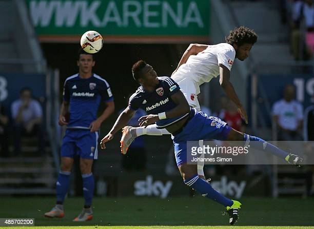 Caiuby Francisco da Silva of Augsburg competes for the ball with Bernardo de Oliveira of Ingolstadt during the Bundesliga match between FC Augsburg...