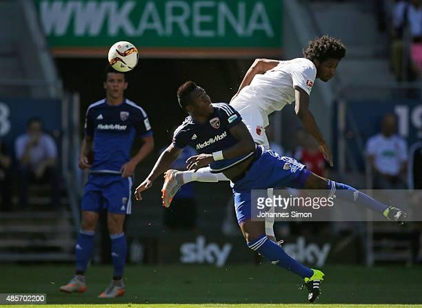 Caiuby Francisco da Silva of Augsburg competes for the ball with Bernardo de Oliveira of Ingolstadt during the Bundesliga match between FC Augsburg...